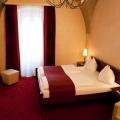 Innenansicht eines Zimmers im 4-Sterne Hotel am Mirabellplatz in Salzburg.
