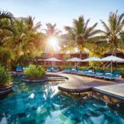 Blick über den Pool den Pool des 5-Sterne Hotel Lux*-Le Morne auf Mauritius.