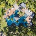 Luftaufnahme auf den Pool des 5-Sterne Hotel Lux*-Le Morne auf Mauritius.