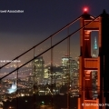 San Francisco bei Nacht mit dem Marin Tower der Golden Gate Bridge im Vordergrund. © San Francisco Travel Association