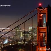 San Francisco bei Nacht mit dem Marin Tower der Golden Gate Bridge im Vordergrund. © San Francisco Travel Association